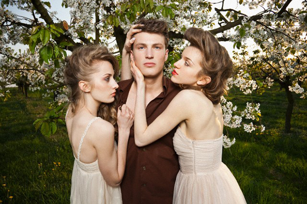 Portrait of man and two women in orchard