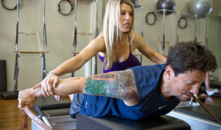 man-training-pilates